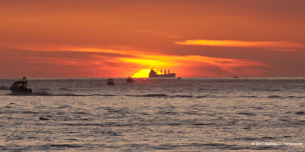 Sun Begins to Rise with Freighter