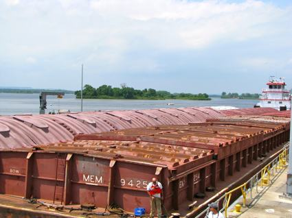 Tug and Barges Navigating Mississippi Lock
