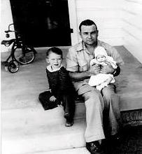 [John McGaughy Jr., with son and daughter]